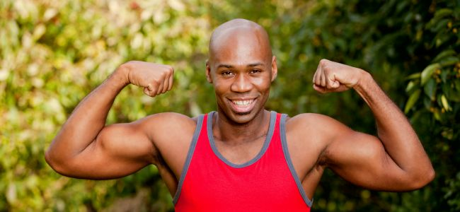 An African American man flexing his Bicep